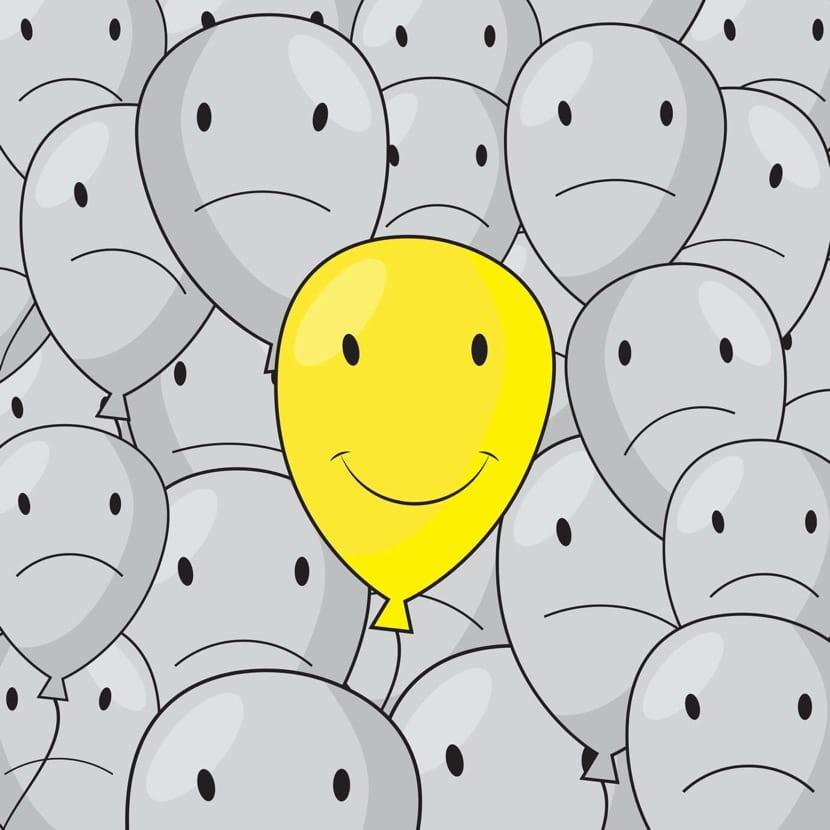 globo feliz entre globos tristes